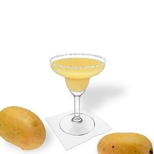 Mango Margarita im Margarita-Glas dekoriert mit einem Zucker- oder Salzrand. Klassiker!